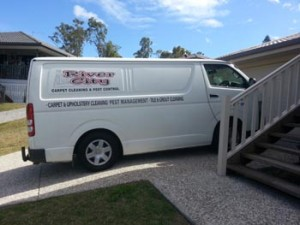 Carpet cleaning van parked on the driveway.
