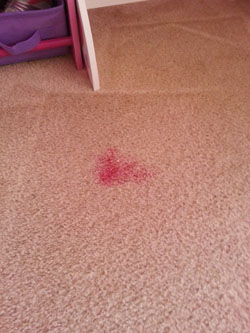 Red stain on carpet