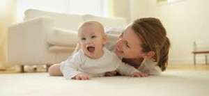 Mother and baby on carpet