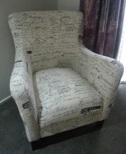 single upholstered chair250